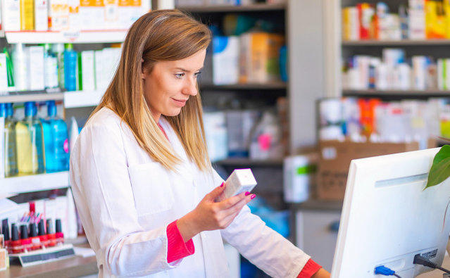 pharmacist looking the inventory