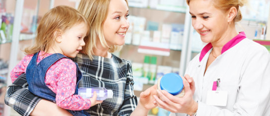 mother and child together with the pharmacist