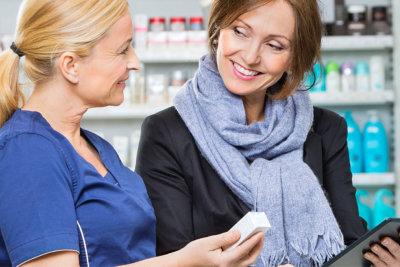 woman pharmacist explaining a medicine to a customer
