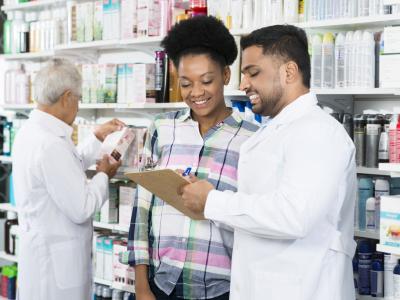 pharmacist talking to a customer