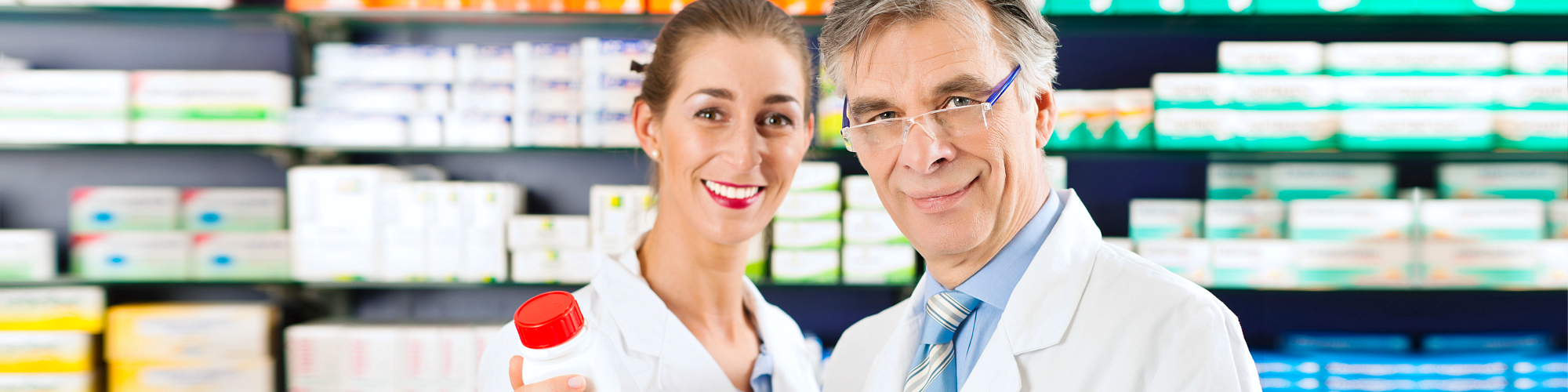 woman and man pharmacist smiling
