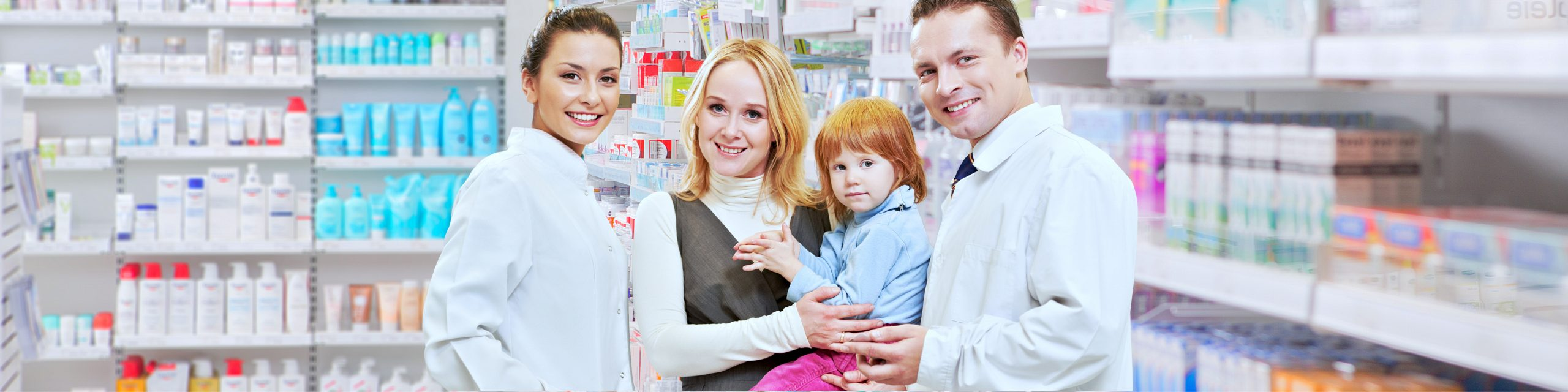 pharmacists with a woman carrying a child